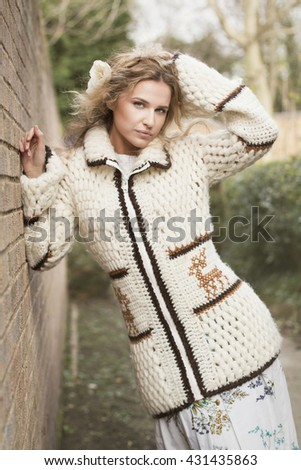 beautiful hippie woman wearing knitted long sweater outdoors - stock photo