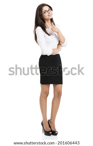 Beautiful hispanic business woman smiling with and pointing, over a white background - stock photo