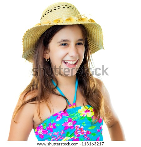 Beautiful hispanic girl wearing a colorful swimsuit and a straw hat laughing isolated on white - stock photo