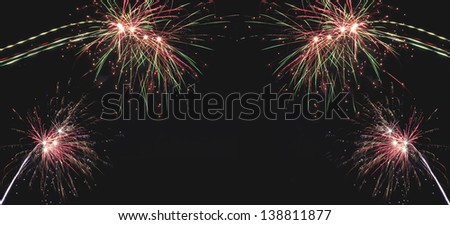 Beautiful  holiday fireworks on the black sky background, long exposure - stock photo