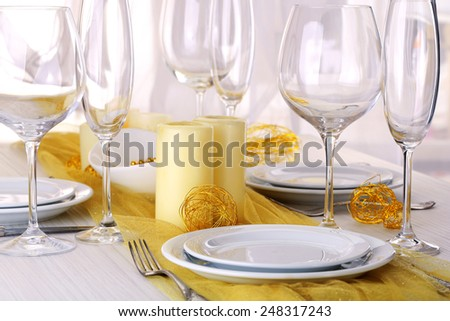 Beautiful holiday table setting in white and gold color  - stock photo