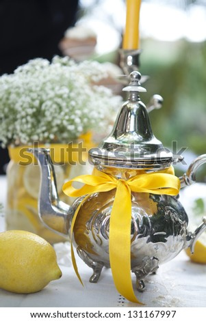 beautiful holiday table setting with lemons, close up - stock photo