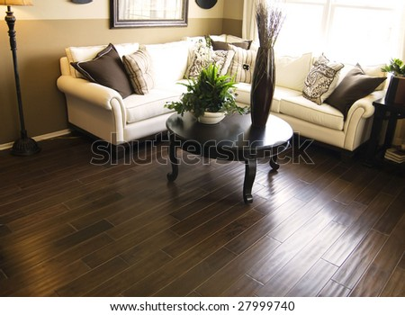 Beautiful home interior living room with hard wood flooring - stock photo