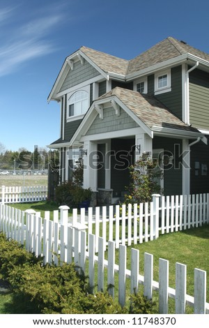 Beautiful Home White Picket Fence - stock photo
