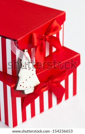Beautiful homemade christmas tree cookie decorated with royal icing and two gift boxes. Selective focus - stock photo