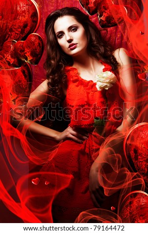 beautiful hot woman in love in red dress around fabric and hearts - stock photo