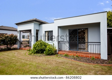 beautiful house against vibrant blue sky - stock photo
