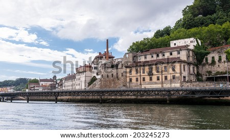 Beautiful houses on the coast of the River Douro in Porto, Portugal. View from the River Douro, one of the major rivers of the Iberian Peninsula (2157 m) - stock photo