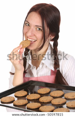 beautiful housewife eating a slice of chocolate cake - stock photo