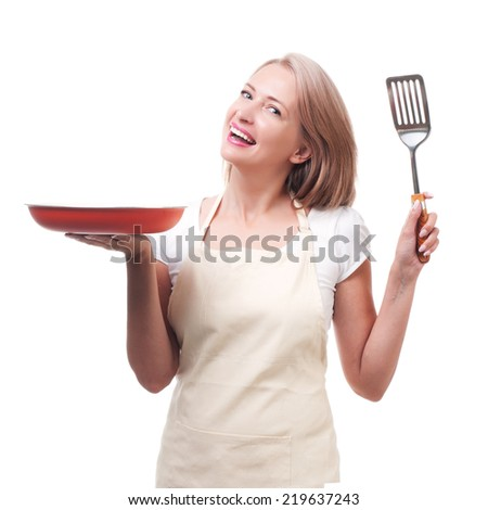 Beautiful housewife with spatula. Isolated on white background - stock photo