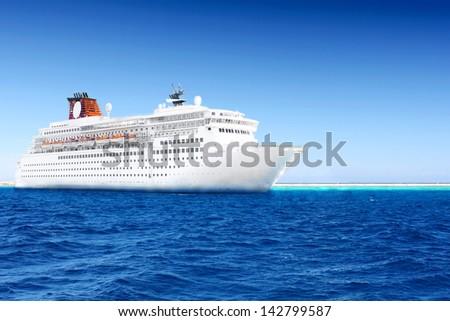 Beautiful huge cruise ship in the sea. - stock photo