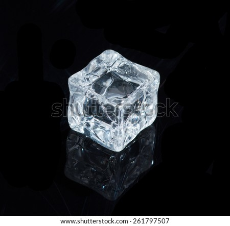 Beautiful ice cube on a black background - stock photo