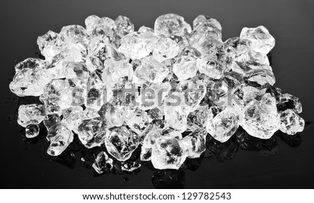 Beautiful Ice cubes. White crystals on a black background - stock photo