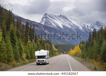 BEAUTIFUL ICE FIELD HIGHWAY, JASPER NATIONAL PARK, CANADA: September 14, 2015 - Tourist RV driving through snow peaked Ice Field HWY in Jasper NP. - stock photo
