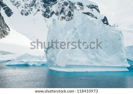 Beautiful iceberg drifting in Antarctic waters - stock photo