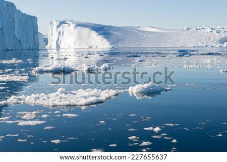 Beautiful Icebergs in Disko Bay Greenland around Ilulissat with blue sky - stock photo