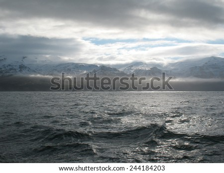 Beautiful icelandic landscape with mountains and ocean - stock photo