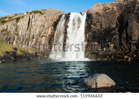 Beautiful Icelandic waterfall. It is located on the West of the island. - stock photo