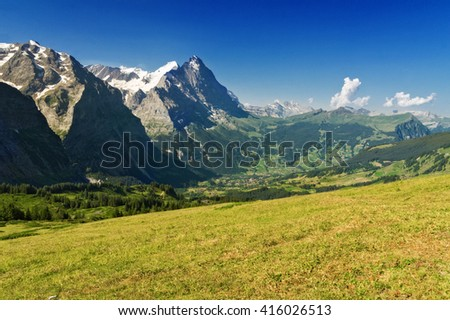 Beautiful idyllic Alps landscape with mountains in summer, Switzerland  - stock photo