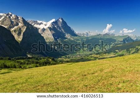 Beautiful idyllic Alps landscape with mountains in summer, Switzerland  - stock photo