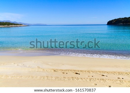 Beautiful idyllic crystal clear turquoise waters shoreline. - stock photo