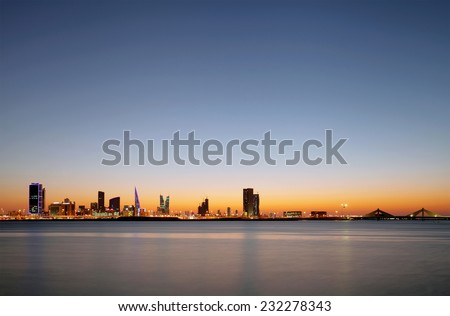 Beautiful illuminated buildings and Bahrain skyline - stock photo