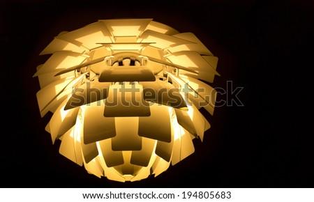 beautiful illuminated modern lamp of danish design - stock photo