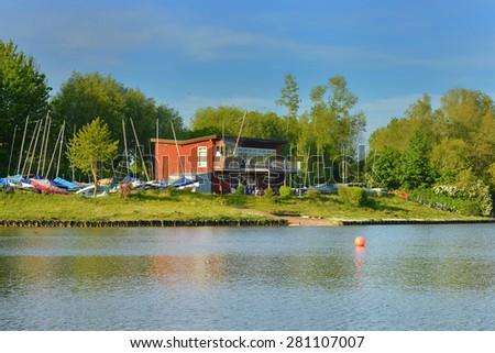 Beautiful image of a boathouse on a peaceful lake - stock photo