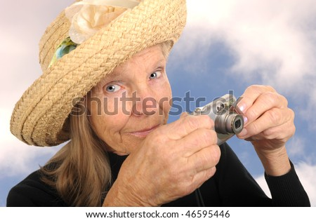 Beautiful Image of a Senior Woman With Camera - stock photo