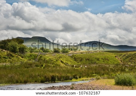 Beautiful image of medieval castle ruins in landscape with blue sky background - stock photo