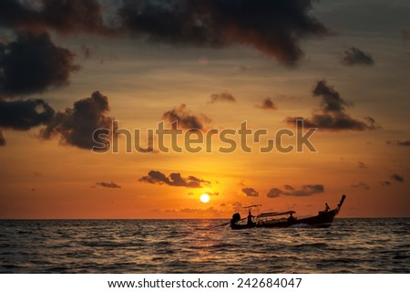 Beautiful image of sunset with colorful sky and Longtail boat on the sea. Thailand - stock photo