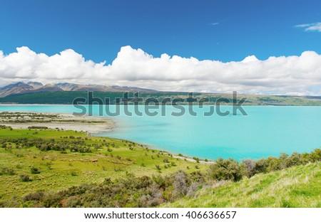 Beautiful incredibly blue lake Pukaki at New Zealand - stock photo