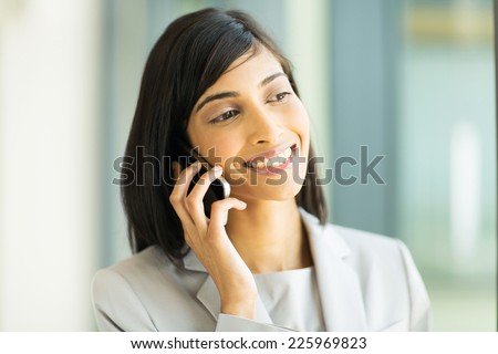 beautiful indian business executive making a phone call - stock photo