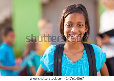 beautiful indian elementary schoolgirl on campus - stock photo