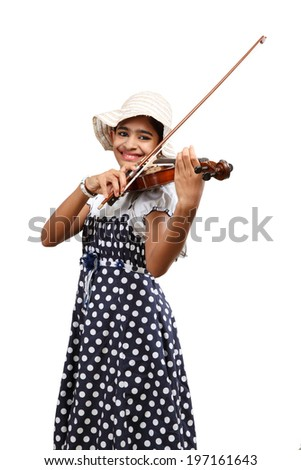Beautiful Indian female playing musical instrument violin , isolated on white background. - stock photo