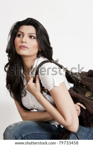 beautiful Indian girl holding handbag. - stock photo