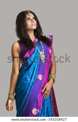 Beautiful Indian girl in traditional Indian sari. - stock photo