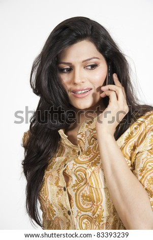 beautiful indian girl using a mobile phone, isolated on white - stock photo