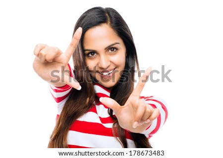 Beautiful Indian woman finger framing photograph white background - stock photo