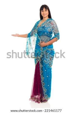 beautiful indian woman welcome gesture on white background - stock photo