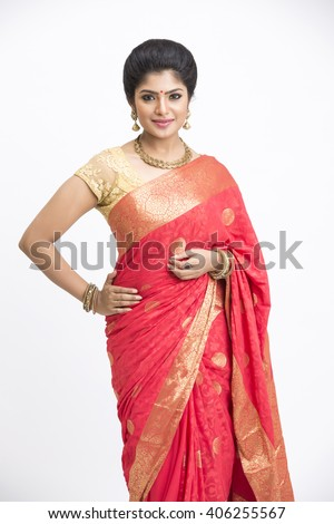 Beautiful Indian young girl posing in traditional Indian saree on white background - stock photo