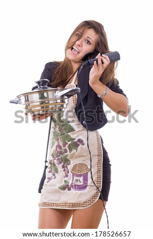 beautiful inexperienced female cook trying to be housewife talking on the phone - stock photo