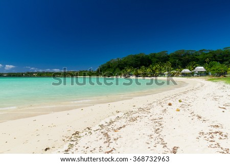 beautiful island beach white sand crystal clear blue sea in pacific ocean with palm coconut trees  - stock photo