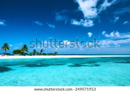 Beautiful island beach with sandspit at Maldives - stock photo