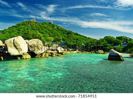 Beautiful island in tropical sea. - stock photo