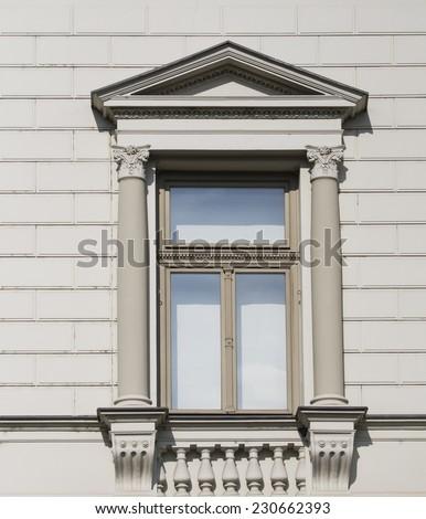 Beautiful Italian windows on building facade - stock photo