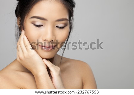 Beautiful Japanese-Chinese woman with closed eyes  - stock photo