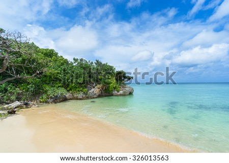 Beautiful Japanese tropical beach with clear turquoise water, Ishigaki Island National Park of the Yaeyama Islands, Okinawa, Japan - stock photo