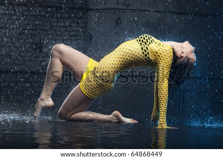 Beautiful jazz dancer in aqua studio - stock photo