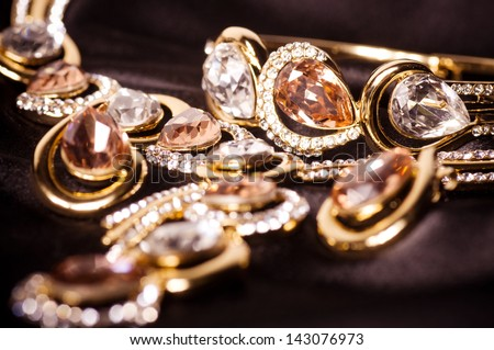 Beautiful jewelry on black background - stock photo